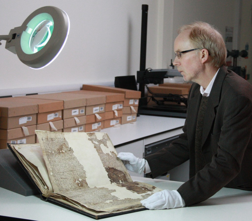KCC archivist Dr Mark Bateson with the Sandwich Magna Carta