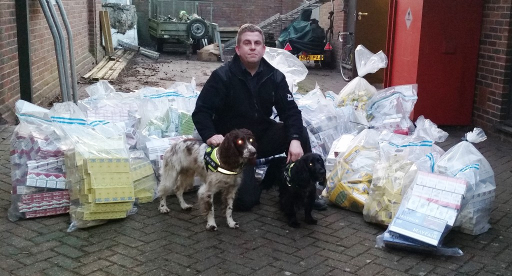Dog handler Stu Phillips with his two sniffer dogs which helped discover the illegal tobacco.