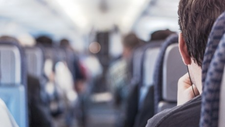 Back of head of rail commuter seated in carriage