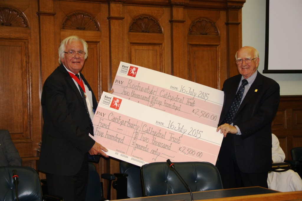 Cllr Peter Homewood hands over the Cheques to Sir Robert
