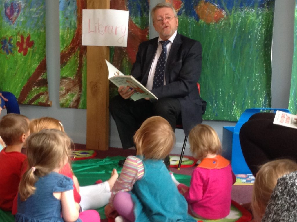 Gary Cooke KCC member for Maidstone SE reading to the children at the Beanstalk from Bump to Beyond project