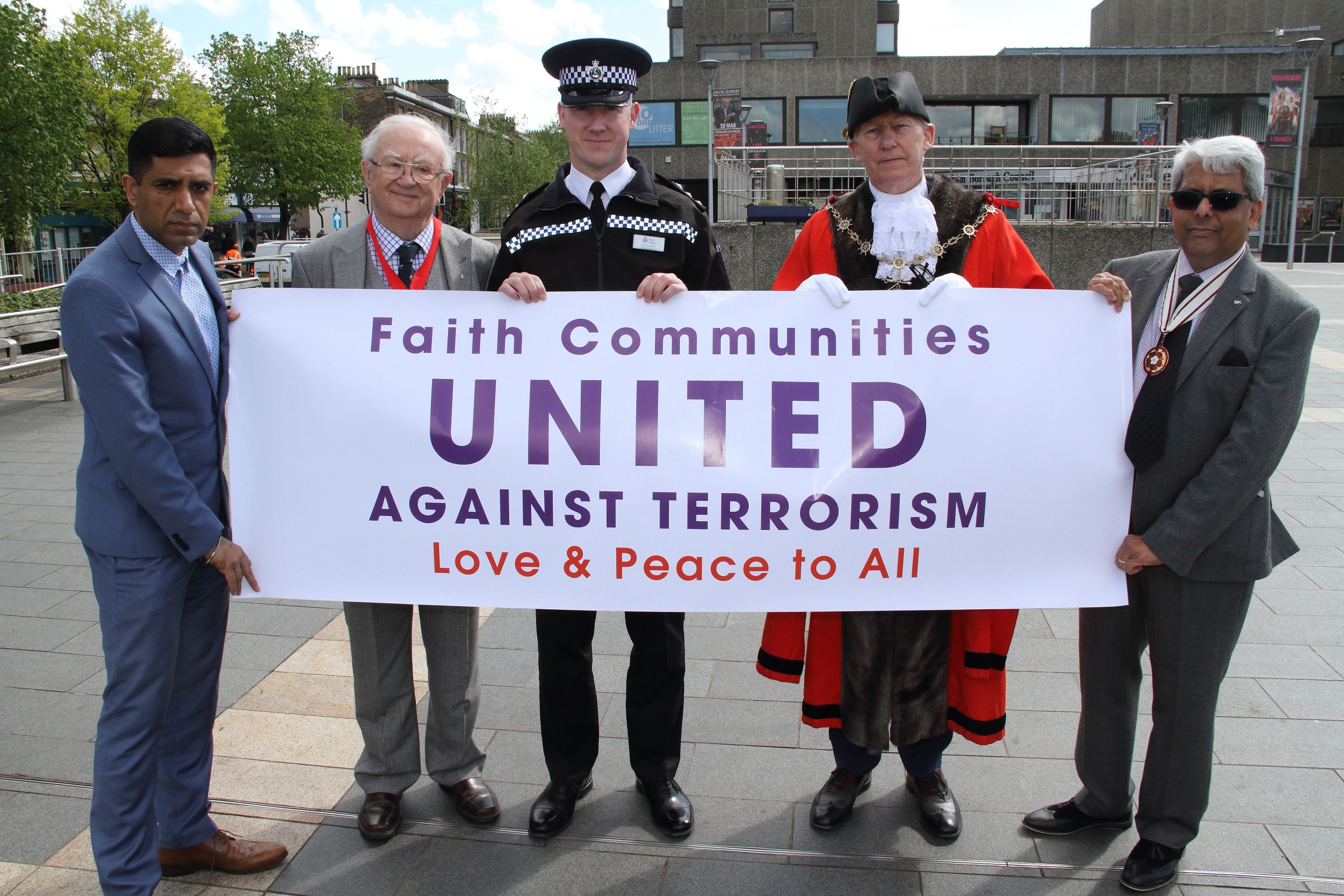 Inter-faith gathering pays respects to terror victims