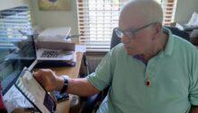 Mr Robert Greenfield using his video carephone.